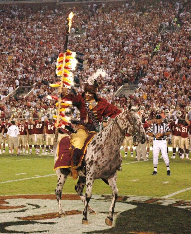 fsu chief osceola  with flaming spear  on renegade at midfield