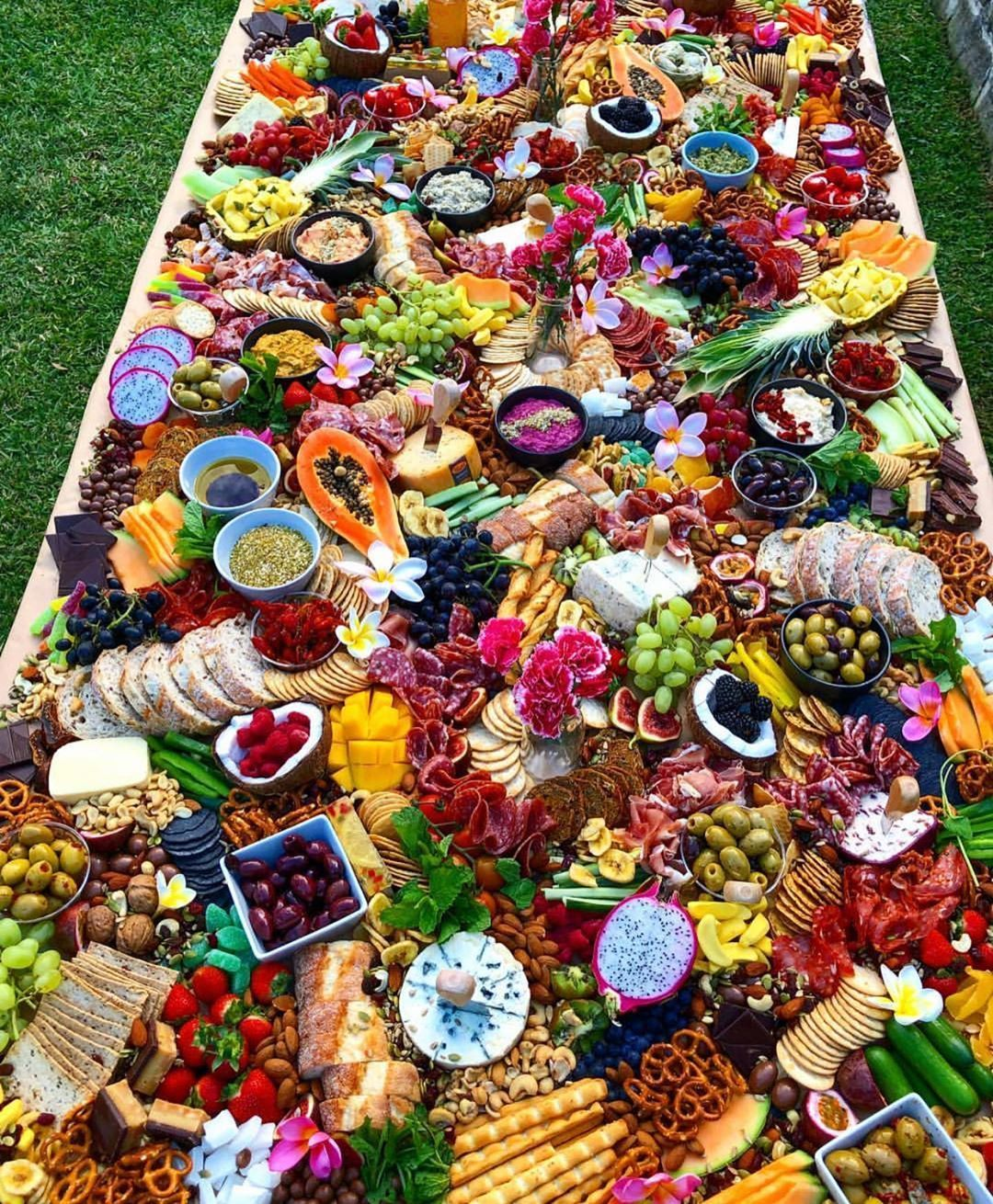 """Grazingtablesandcheeseboards on Instagram: """"Who wouldn't want a huge table of deliciousness. **Please note that the flowers on this table are not edible and should never be used on a…"""""""