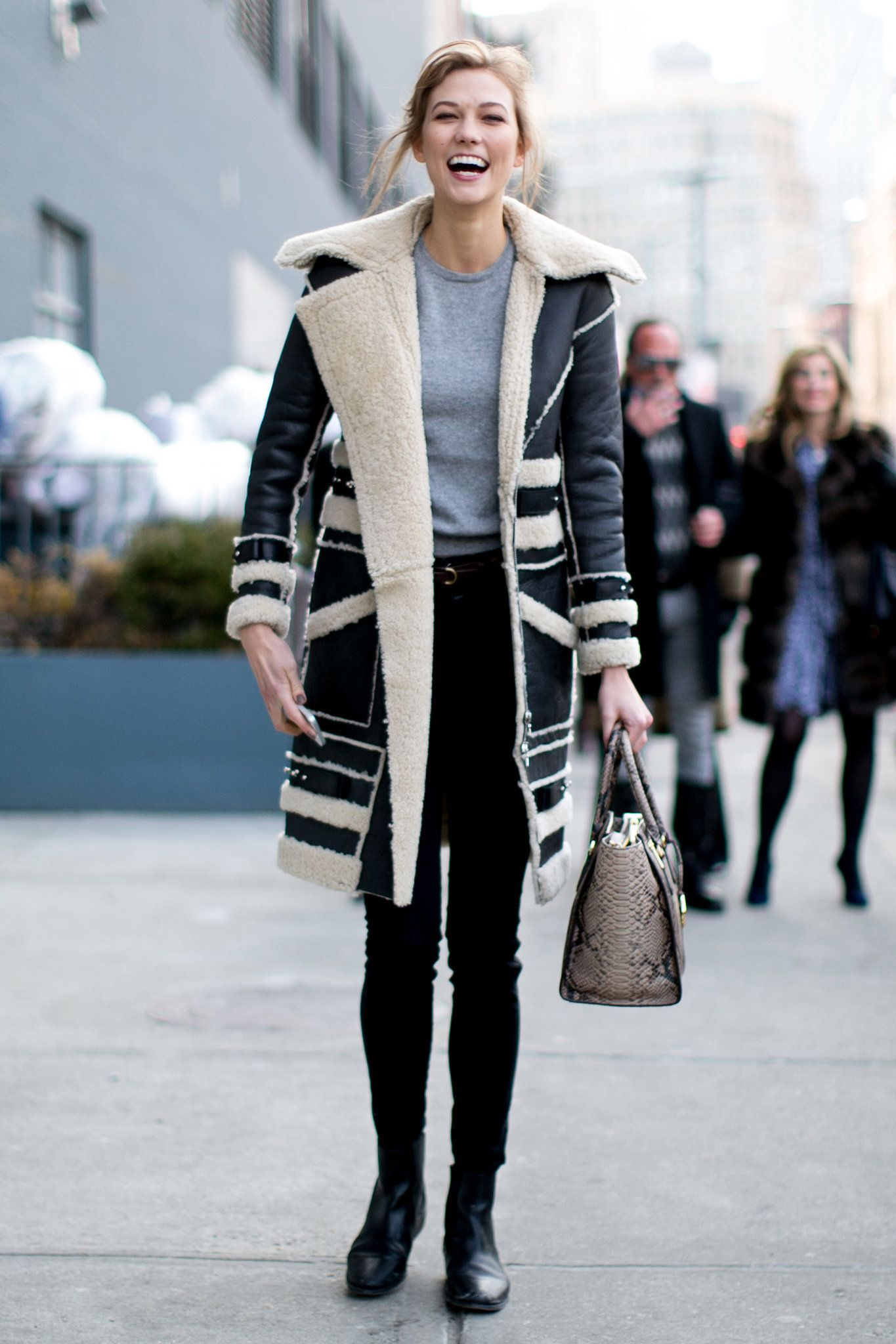 Is it just us, or does Karlie Kloss have the best shearling coat (and smile)?! Model Street Style at New York Fashion Week #NYFW
