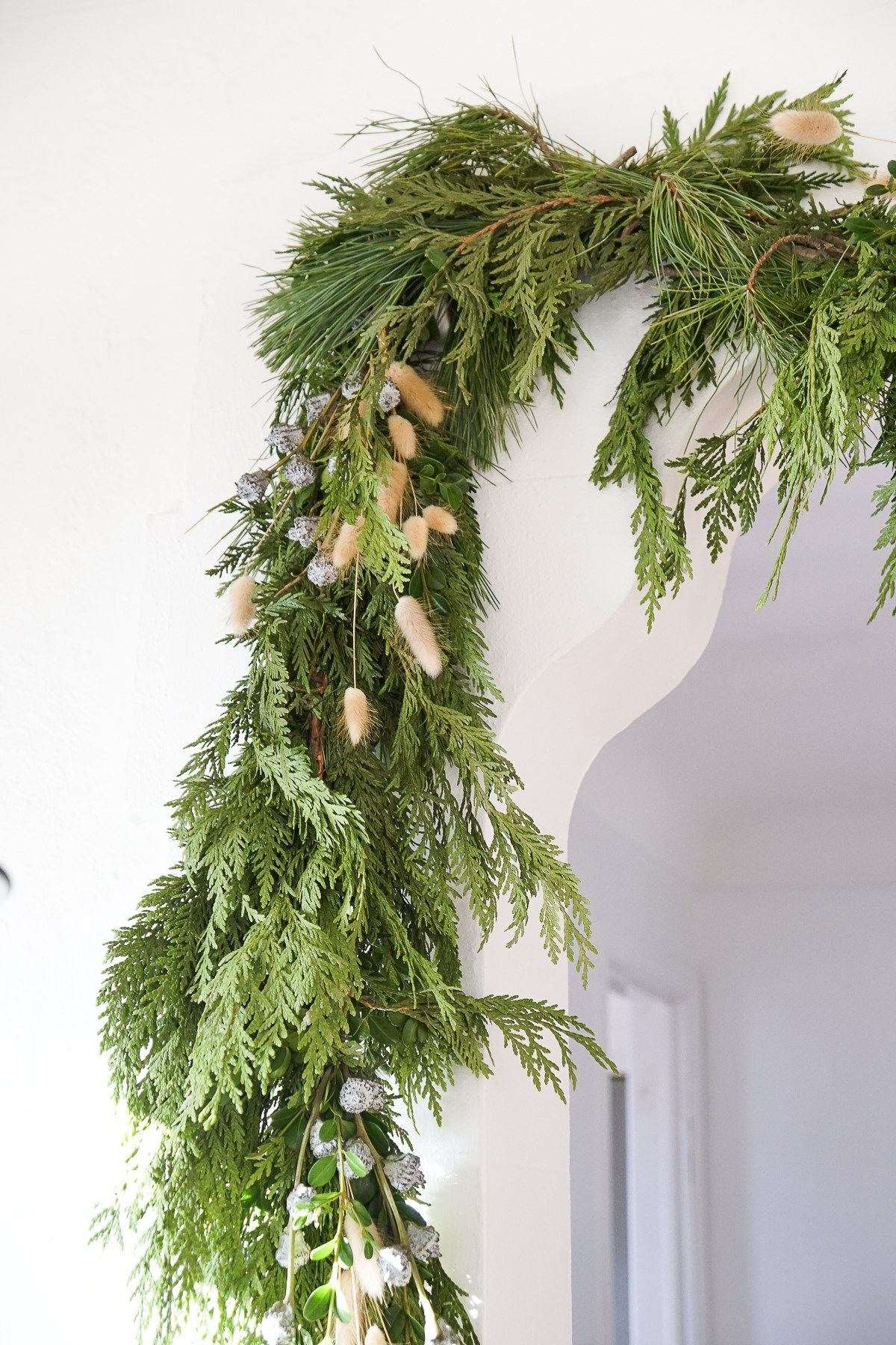 How To Hang Heavy Garland Without Damaging Your Walls Christmas