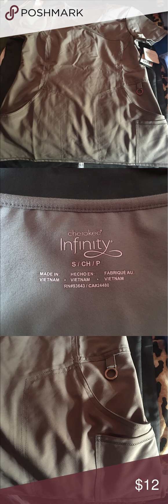 Small Scrub Top Cherokee Infinity top. Grey. No bottoms available. Great stretchy material. A lot of pockets. Original price 31.99 Cherokee Tops Tees - Short Sleeve