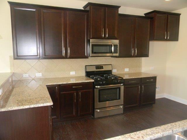 New Venetian Gold Granite Kitchen With Dark Cabinets And Dark