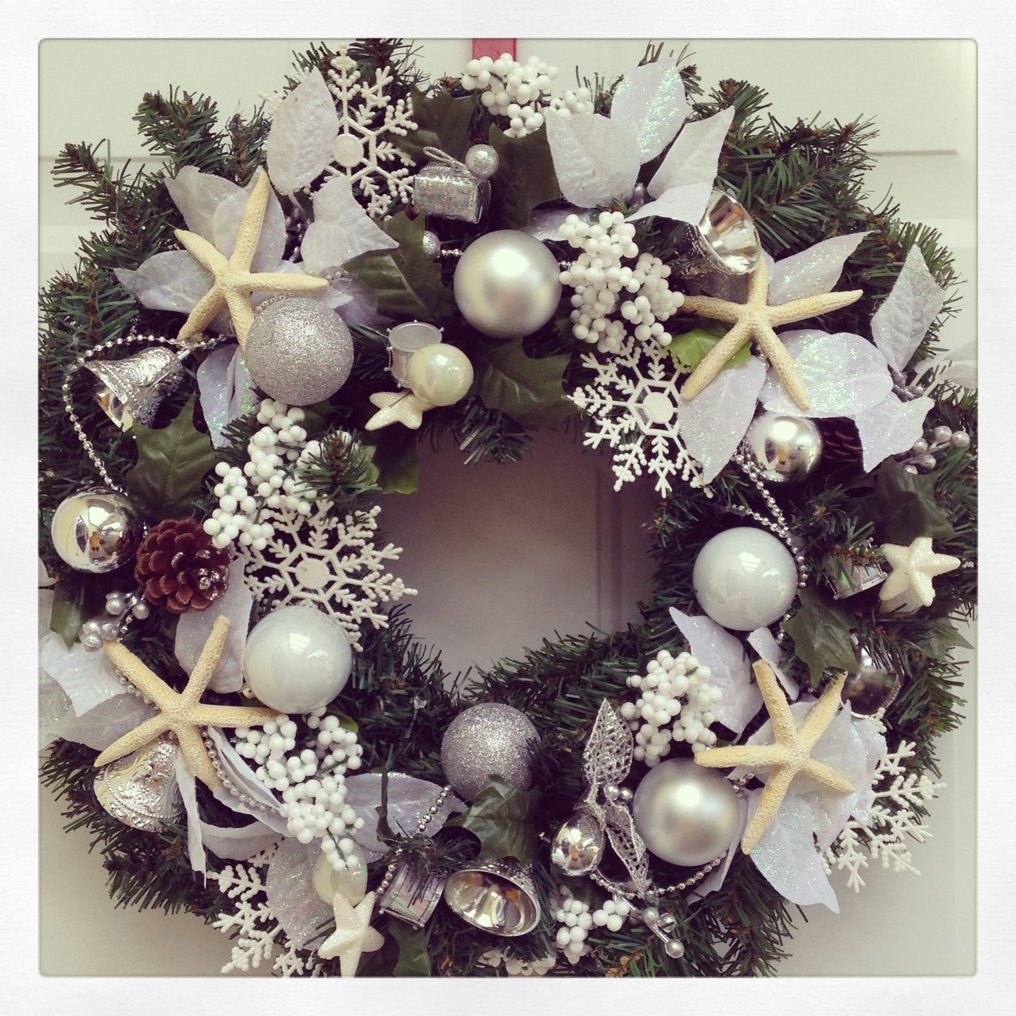 Whipped this up this morning using a plain $2 thrift store #wreath and #DollarTree picks. Resin #starfish were purchased this summer at #ChristmasTreeShoppe in NY. coastalChristmas #lovefl