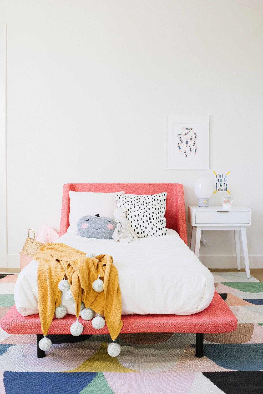 Girls Bedroom With A Pink Bed Frame White Duvet Mustard Yellow Throw Blanket Fun Colorful Area Rug Colorful Kids Room Pink Toddler Rooms Toddler Girl Room