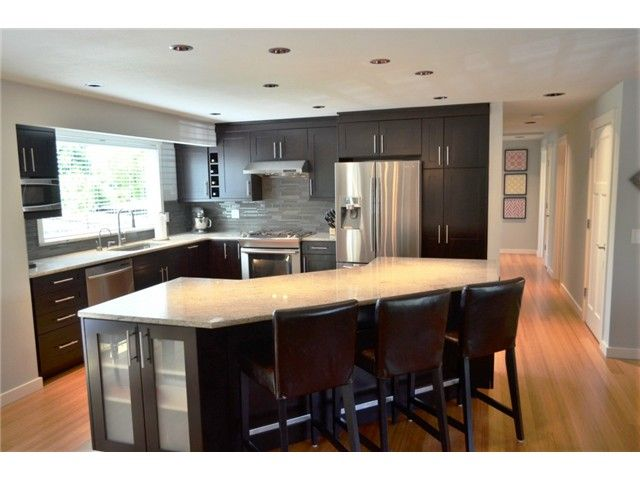 Open Kitchen With Angle Island Split Level Living Room