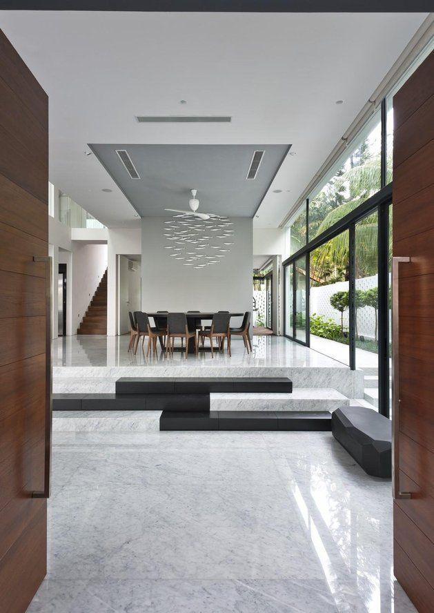 Luxury pool house under unique roof