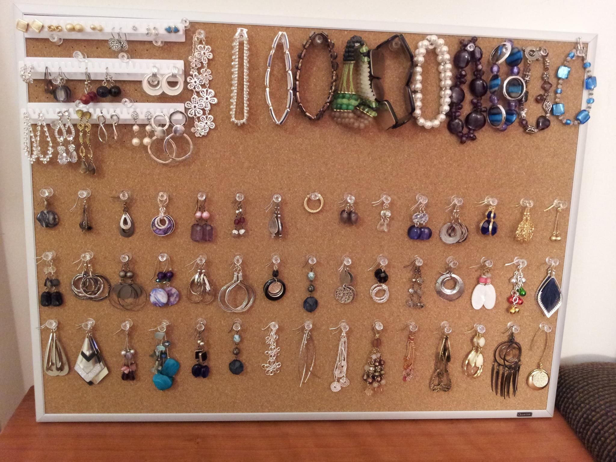 Jewelry holder made from corkboard pushpins White earring