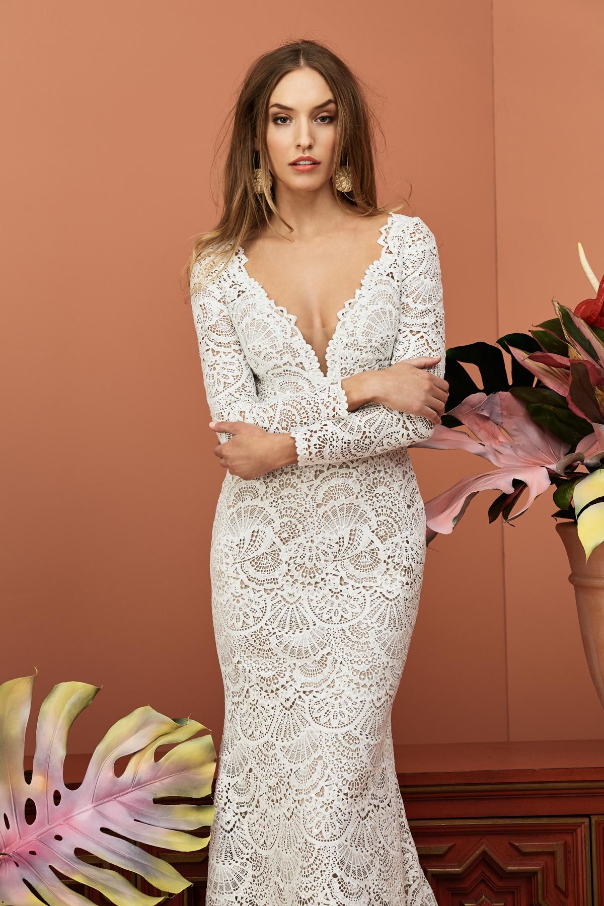 Low cut wedding dresses  With a lowcut Vneck and Galen lace this stunning wedding gown