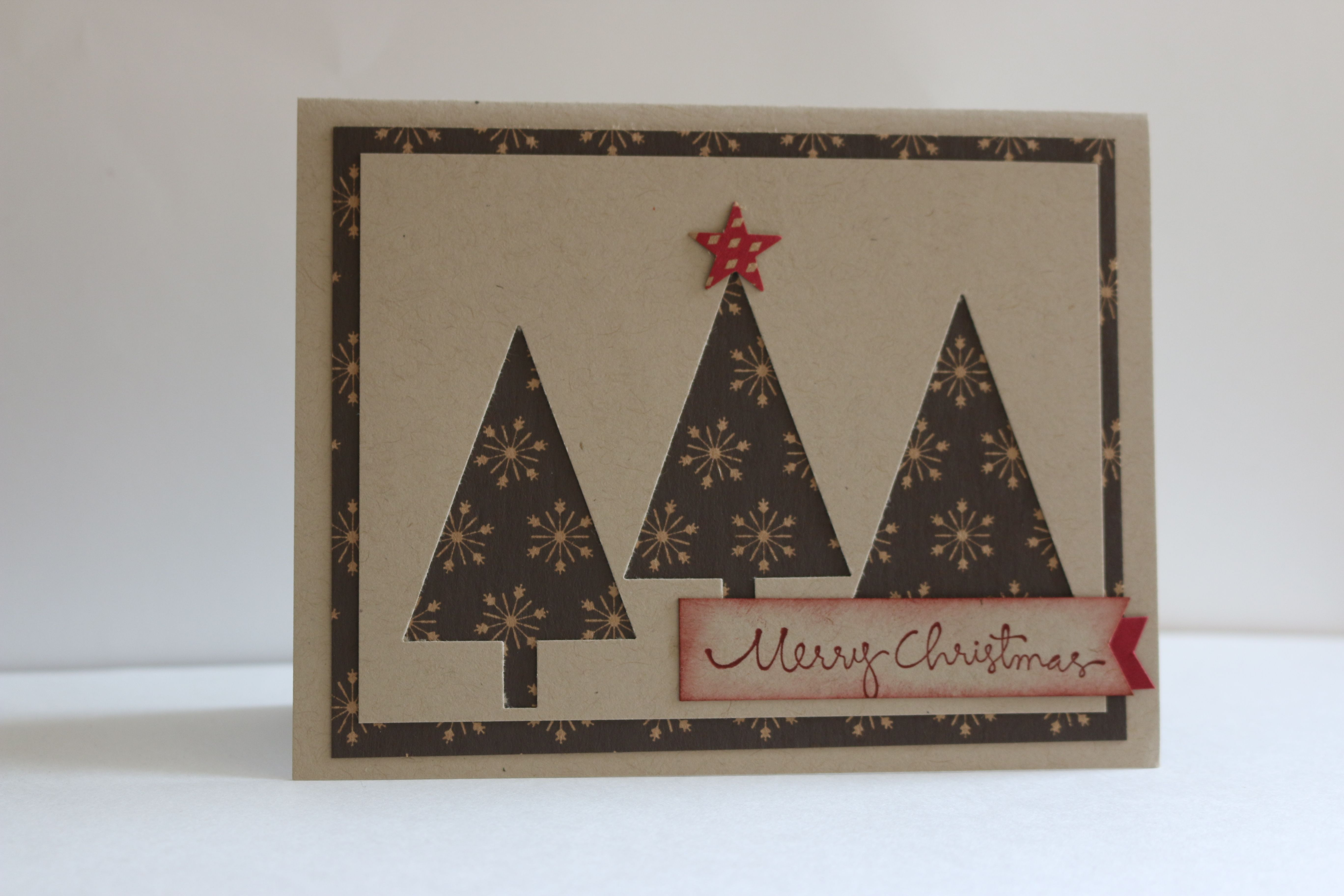 Under the Tree DSP, Tree punch, Star punch, Red glimmer cardstock.  All product of Stampin' Up!