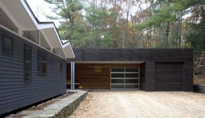 Our minimalist garage / front porch addition, along with the high contrast color palette, helps shift the focus back to the floating white accordion roof.