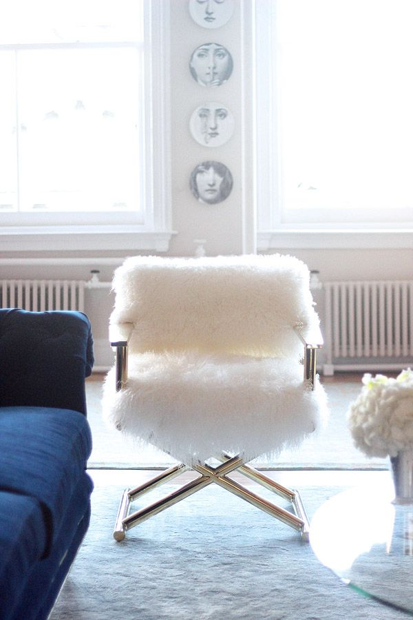fuzzy white chair invisible trick soho nyc loft tamra sanford fornasetti plates room