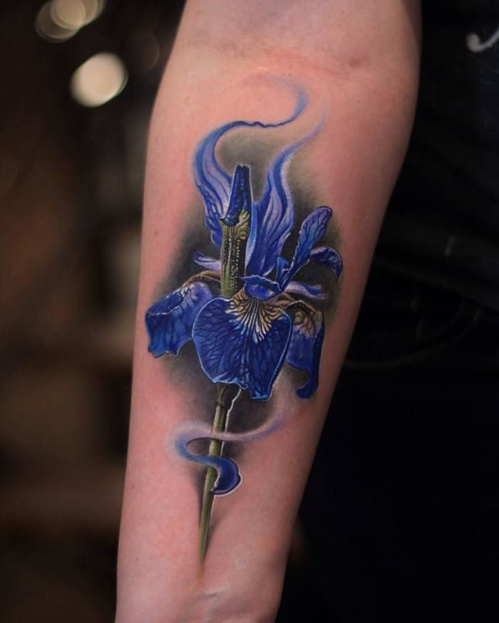 22 Grandiose Iris Tattoo Designs And Meanings Tattoobloq Iris Tattoo Iris Flower Tattoo Tattoo Designs And Meanings
