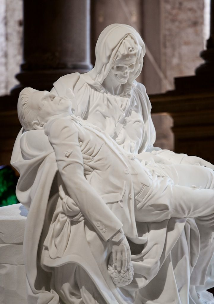 Belgium-based artist Jan Fabre created five magnificent white marble sculptures based on variations of Michelangelo's Pietà, the iconic image of Mary cradling the dead body of her son Jesus in her arms. Adding his own unique twist to the iconic work, Fabre puts himself in the place of the Christ figure, and replaces Mary's face with a skull.