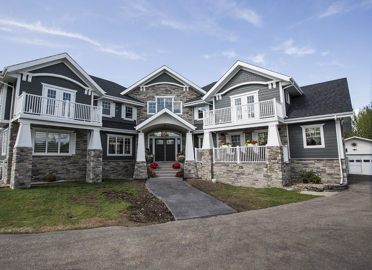Alair homes edmonton rebuild a mix of traditional for Modern transitional house plans