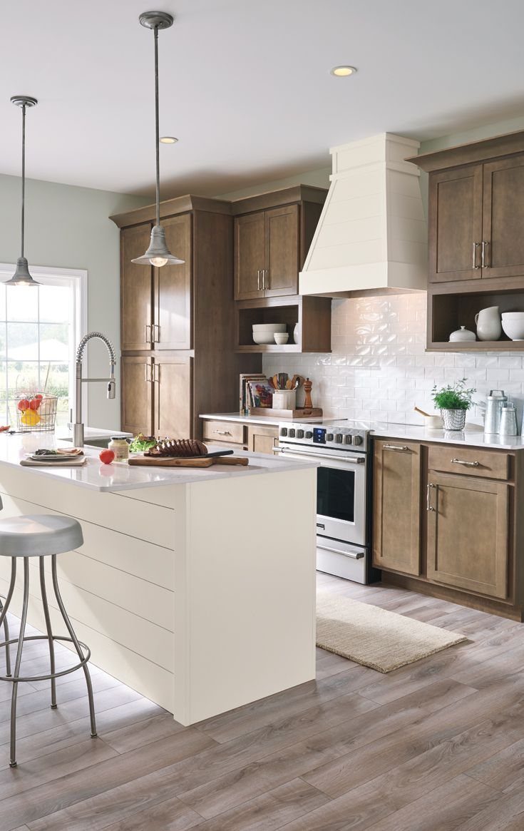 Clean lines and easy living cabinet colors take this ...