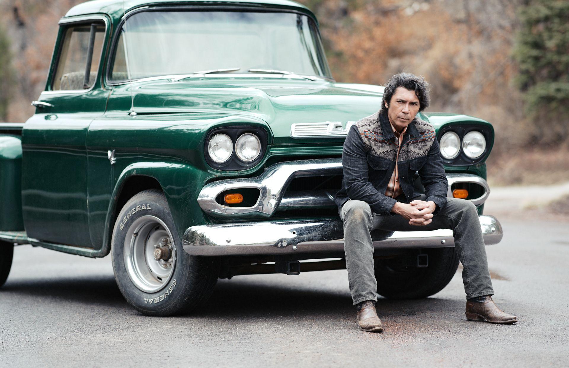 Photo of Lou Diamond Phillips  - car