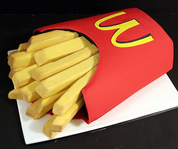 Bring the Golden Arches to the altar. If your groom has a weakness for McDonald's, this creative French fry cake could be just right.