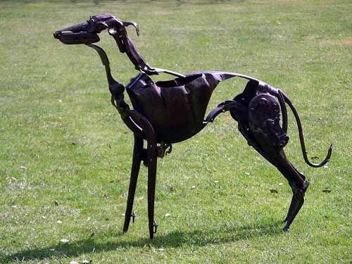 scrap metal dog sculpture by artist helen denerley titled kipper scrap metal