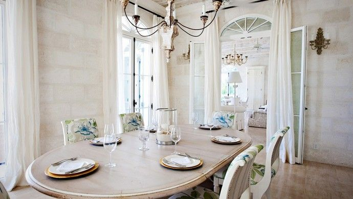 Amazing Grace An Artsy Chandelier And Gauzy White Drapes Complete The Dining Room Decor