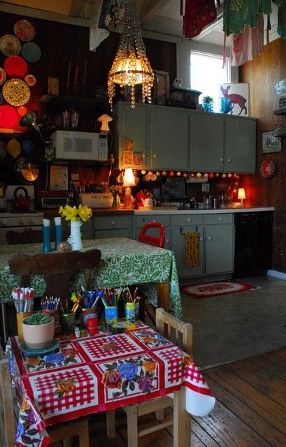 So many things to love about this funky kitchen. Especially love the kids table (complete with art supplies) next to the grown ups table