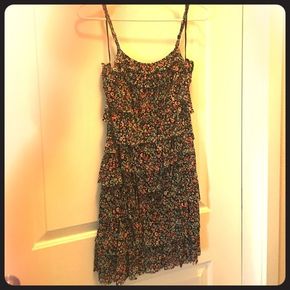 Boho chic summer dress Never worn, light summer dress. Ruffled layers and chic floral print. Stretches and fits more like a S/M. Express Dresses Midi
