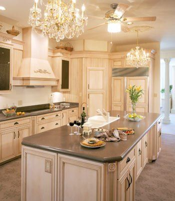 cream cabinets walls and backsplash - paired with counter ...