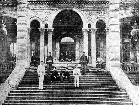 "The provisional government set up guard in front of Iolani Palace, at that time called the Executive Building, during the 1893 ""Restoration crisis."""
