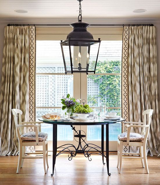 An Over Scale Lantern Lends Drama While Ikat Patterned Curtains Smooth It Out