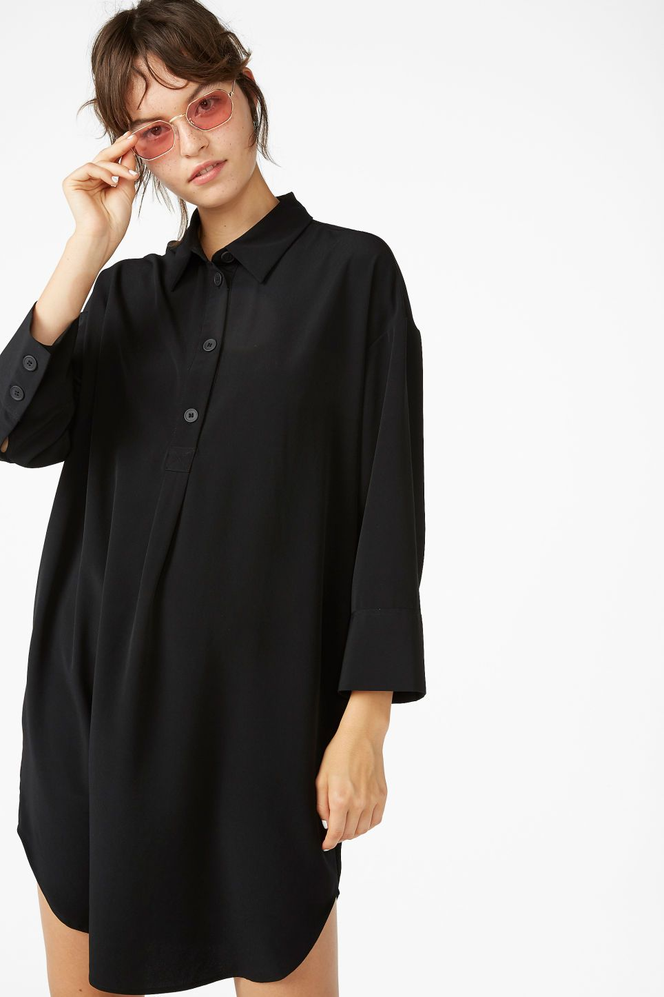 43aa61a1 Cut from a crisp, textured material, this wide and flowy shirt dress has a  button-up front and extra wide cuffs. In black, it s the definition of ...