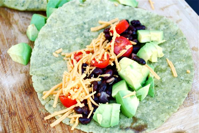 Vegan Black Bean Burrito (Gluten Free) Recipe Main Dishes with dried black beans, olive oil, onions, garlic, tomatoes, cumin, oregano, sea salt, water, gluten free tortillas, shredded cheese, avocado, tomatoes, purple onion