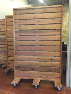 Portable wood partition maybe make with slat wall visual for Pallet wall on wheels
