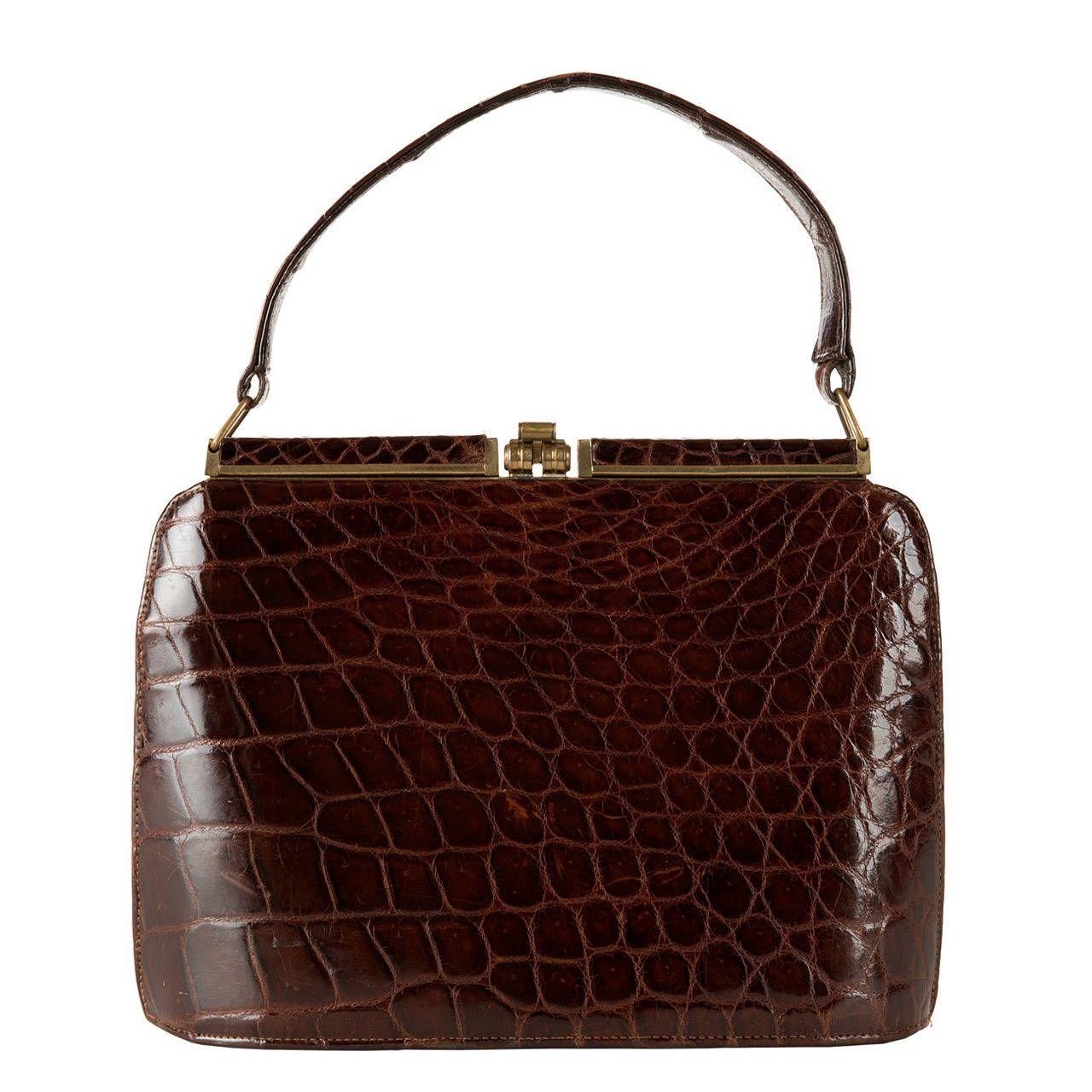 A Vintage Dark Brown Crocodile Handbag   From a collection of rare vintage handbags and purses at https://www.1stdibs.com/fashion/accessories/handbags-purses/