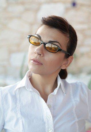 Black Frame,  Brown, Dark Gold Lenses. AVANGLION