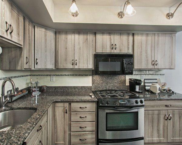Best Gray Barnwood Kitchen With 4 Inch Backsplash 400 x 300