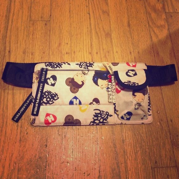 "Harajuku lovers fanny pack Super cute adjustable fanny pack! Purchased this few years back at Macy's! Has some wear but overall in good condition! All zipper works and has 3 pockets/compartments. The dimension for the fanny pack is L 10"" x H 5"". Harajuku Lovers Bags Travel Bags"