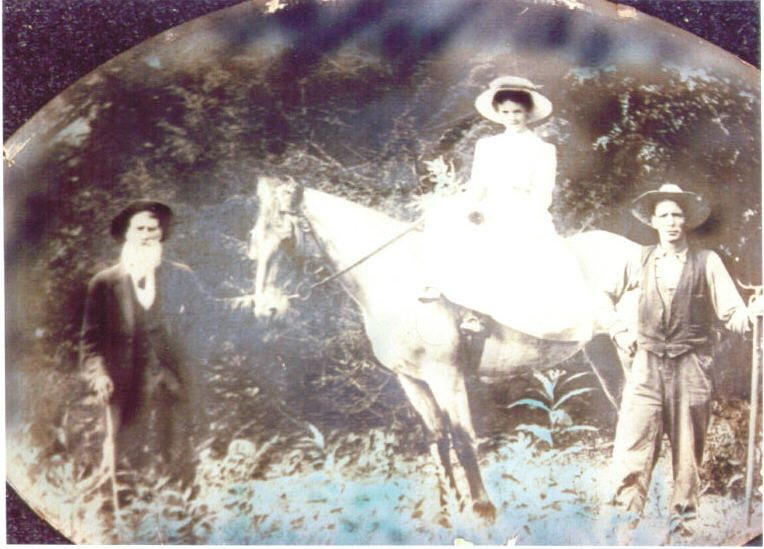 Simon Forbes on left, is the father of Abraham M. Forbes. He was a physician. On the horse is his granddaughter Nancy Forbes and on the ground is her husband Will Colbaugh. Nancy is Daniel Forbes daughter. Daniel is Abraham's brother.