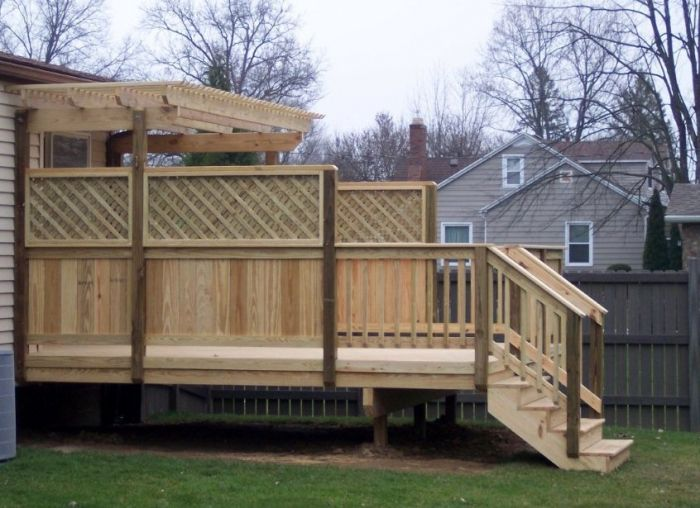 A wood deck with a trellis pergola note the privacy for Wood patio privacy screens