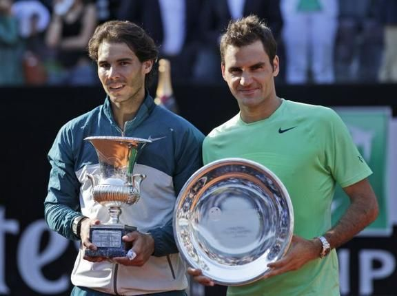 Rafael Nadal Of Spain Left And Second Placed Roger Federer Of Switzerland Hold Their Trophies During The Awar Roger Federer Rafael Nadal Tennis Tournaments