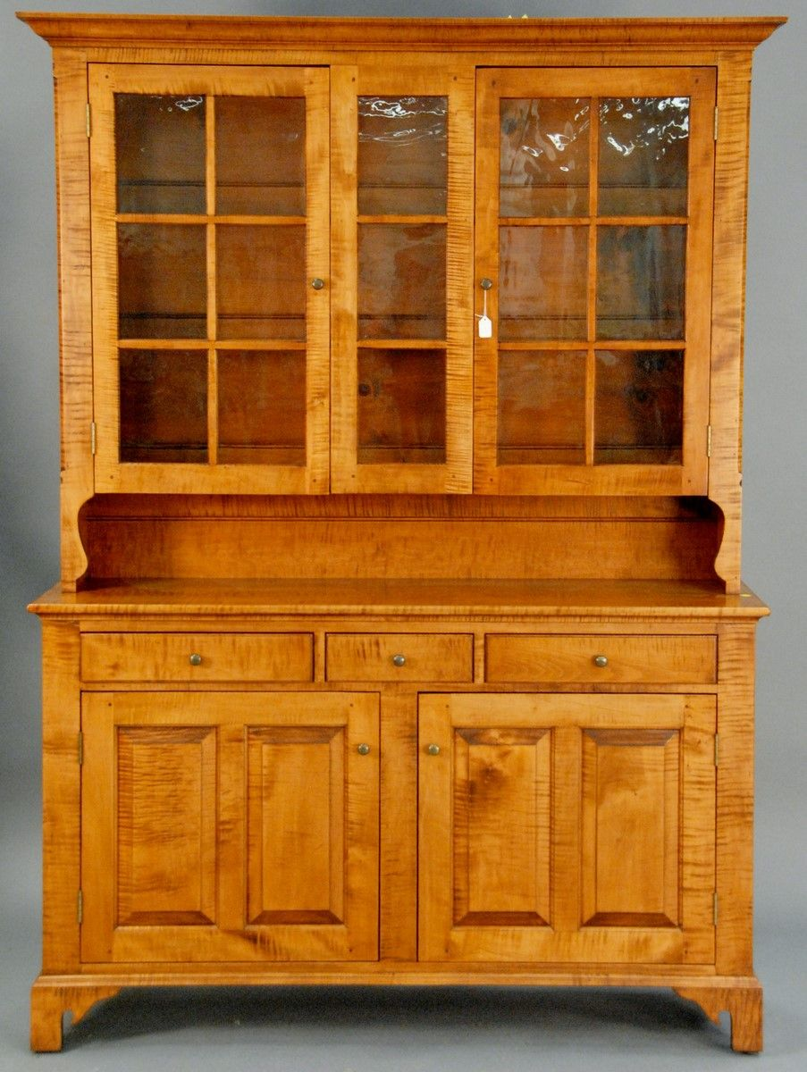 D.R. Dimes figured maple hutch in two parts, upper section with ...