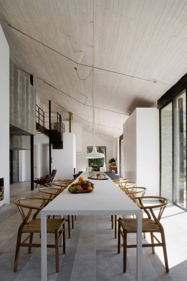 Simple Very Long Dining Table With Lots Of Lovely Wishbone Chairs