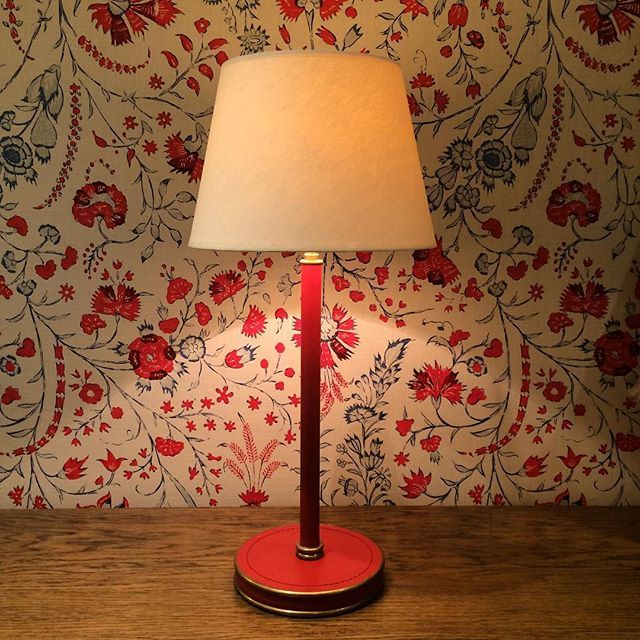 Soane britains leather wrapped weymouth table lamp shown with dianthus chintz linen in our london showroom