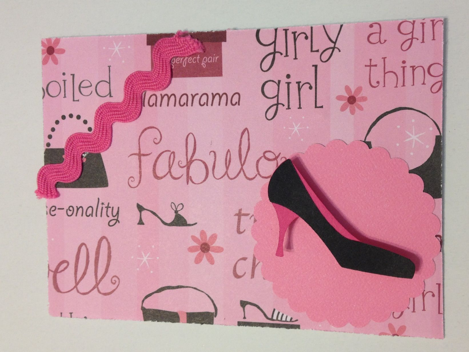 Rayana's( my daughter) shoe card.  She used misc ribbon & paper.  Shoe is a Quickutz/Lifestyle crafts die.
