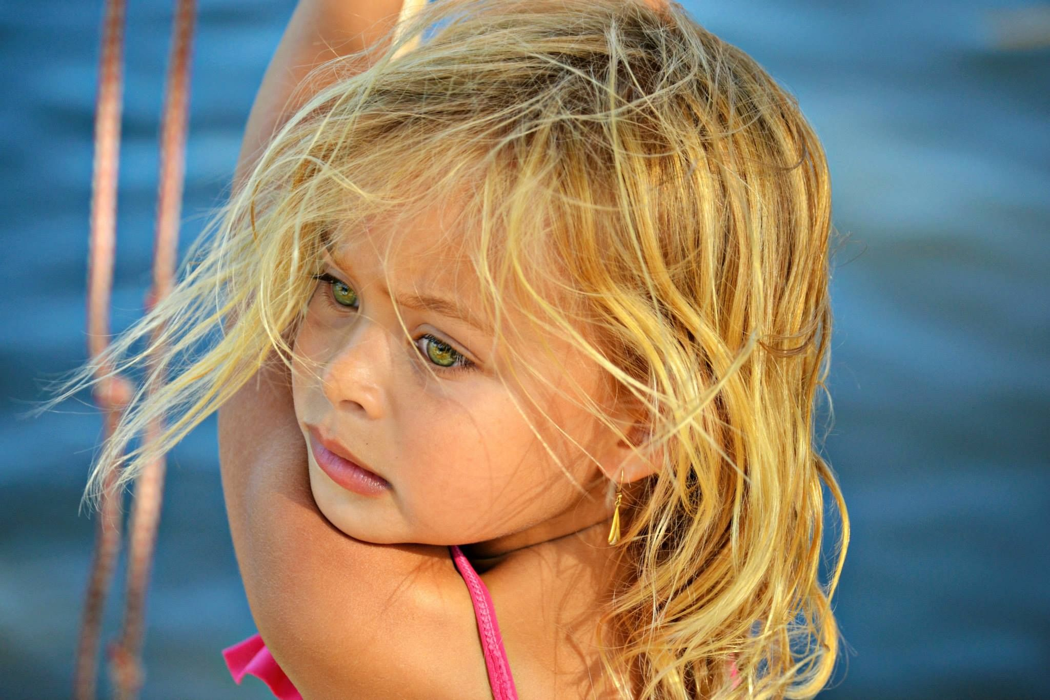 Beautiful Child With Blonde Hair Green Eyes And Tanned Skin