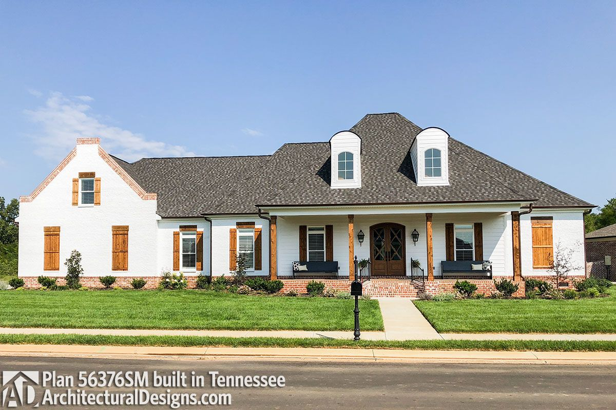This acadian style house has a beautiful brick and stucco facade with two dormers centered over the 35 long and 8 deep porch the foyer gives you views
