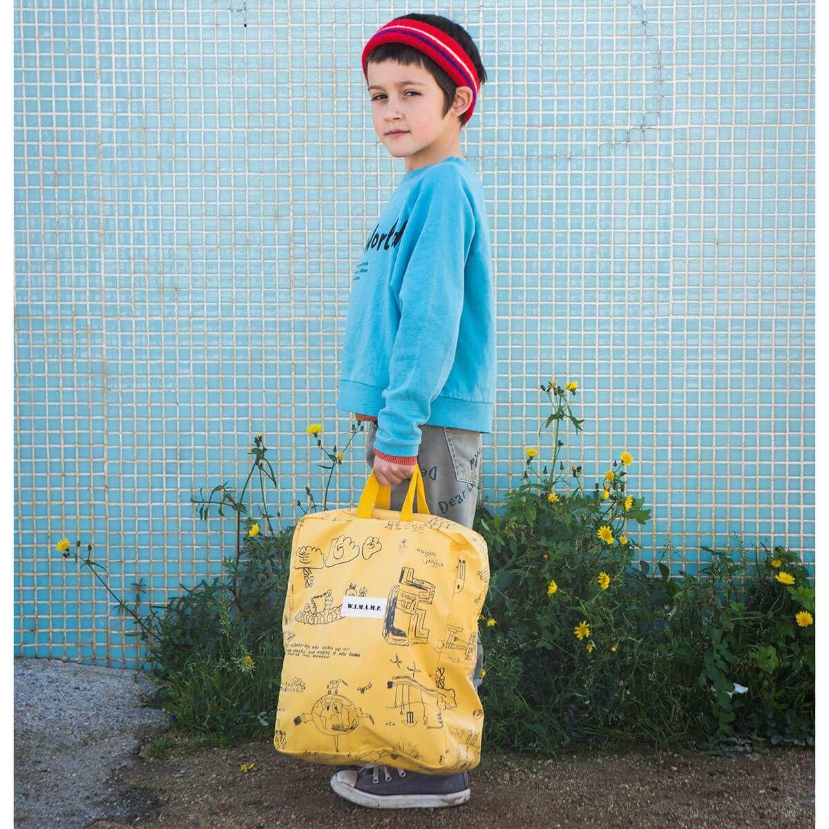 91c481447d8d W.I.M.A.M.P. School Bag in Yellow by Bobo Choses