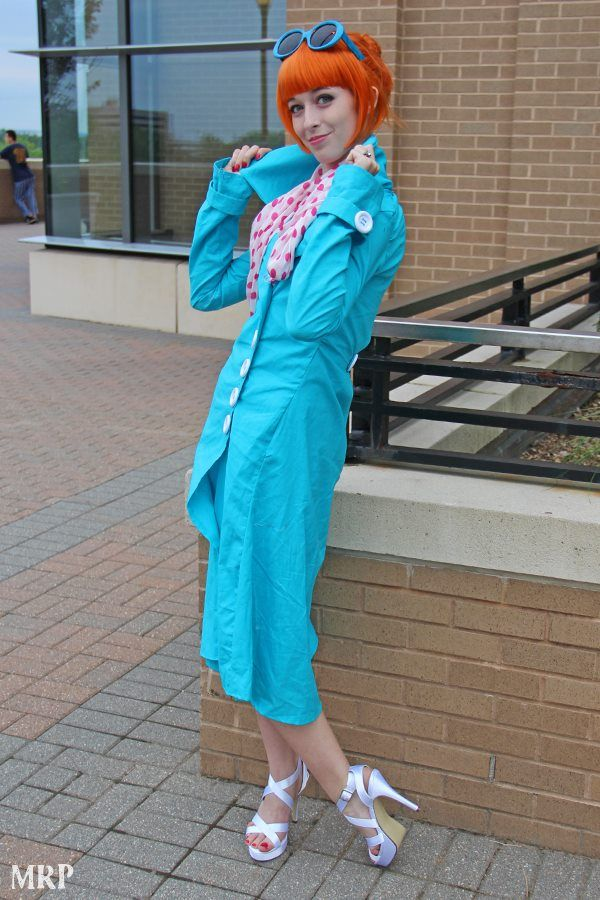 Agent Lucy Wilde Despicable Me 2: turquoise coat and sunglasses, red hair, red polka dot scarf