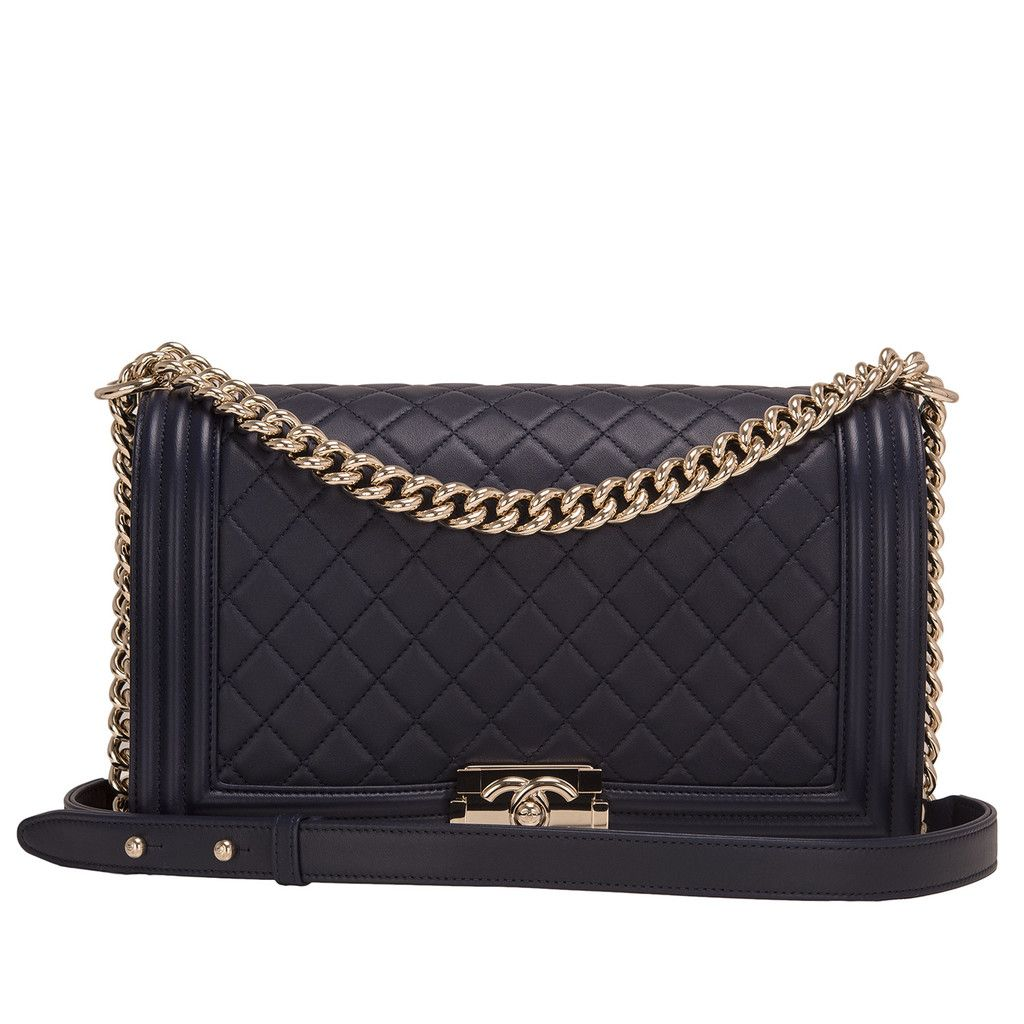 922e72fb1d4a Chanel New Medium Boy bag of navy lambskin leather with light gold tone  hardware. AVAILABLE NOW For purchase inquiries, Please Contact: Email: ...