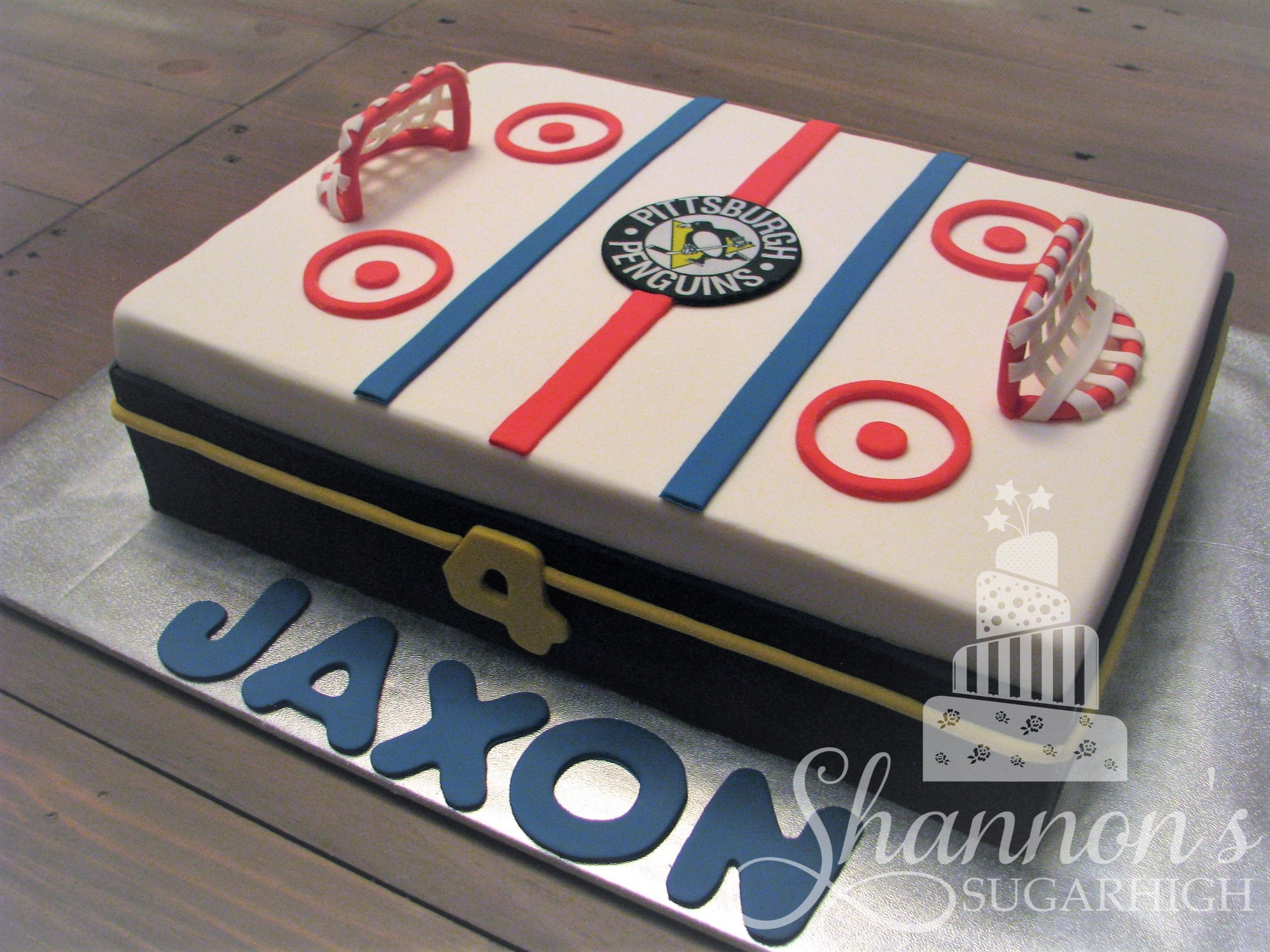 Fondant covered hockey rink cake for a 4 year old who loves the