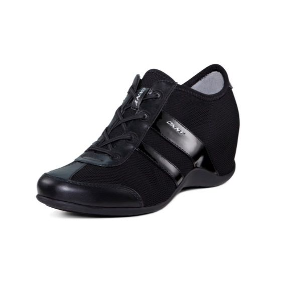 efbae59c1e2 DKNY Black Paige Wedge Sneakers Easy slip on DKNY women s fashion wedge  sneakers. They have faux laces and subtle hidden lift wedge