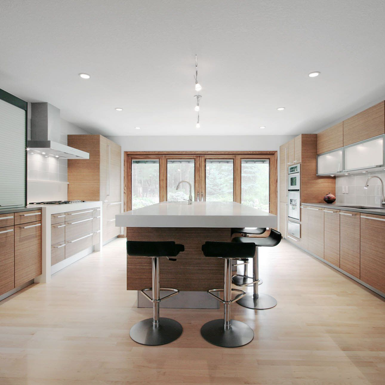 Large window kitchen designs  panoramic windows bring views of the surrounding woodland into this